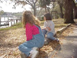 Carol and Kiley overlook the Inter Coastal Waterway on Bluff Drive - 1999
