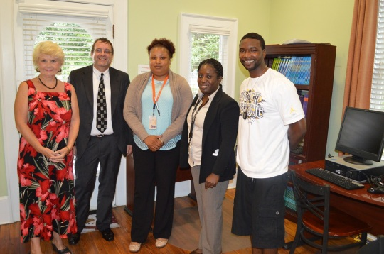 Pictured left to right: Linda Hilts, Executive Director Park Place Outreach – Youth Emergency Shelter; and South University volunteers: Ronnie Hall, Desktop Analyst; Tomika Leverett, student; Kimberly Nixon, IT Program Director; Christopher Vinson, student.