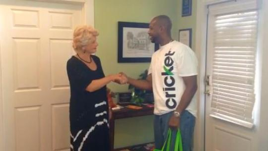 Kevin Dunson, Sales and Marketing Specialist at Cricket Wireless, presents Linda Hilts, Executive Director of Park Place Outreach – Youth Emergency Shelter, with personal hygiene and toiletry items on Wednesday, June 6. Cricket Wireless also supplied pizza for all of the resident children, employees and volunteers of Park Place Outreach.