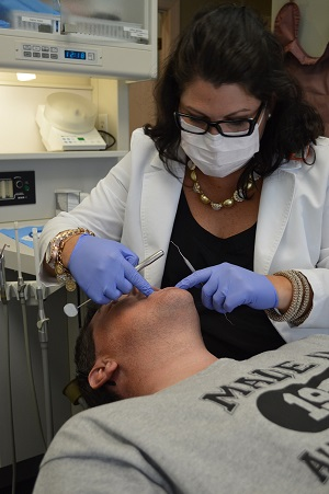 Angela Canfield, DDS, working on a patient