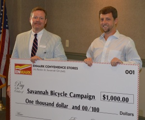 Matt Clements (RIGHT), Director of Marketing for Enmark Stations, presents John Bennett (LEFT), Director of the Savannah Bicycle Campaign, a check for $1000