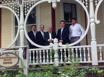 (LEFT to RIGHT) Chris White and Franklin Williams of Celia Dunn Sotheby's International Realty, stand in front of the historic downtown home with previous owner Herbert Gallaway and new owner, Jacob Thompson and Richie Sturgess of Savannah Realty.
