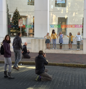 CAPTION: Robyn Shirley (Far Left) oversees Photo Shoot for Spring Collection of Matilda Jane Clothing National Marketing Campaign. Models (L to R): Anna Lou Lindler, Emma Claire Buckaloo, Bradley Lindler, Charlotte Powers and Lily Wills, line up in front of the Jepson Center on Thursday, December 11.