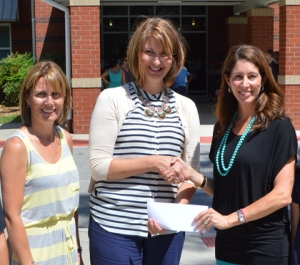 (RIGHT TO LEFT) Robyn Shirley, Independent Trunk Keeper for Matilda Jane, presents a $1000 check to Mary Beth Roulston, Assistant Principal, and Susan Batten, PTO president, of Pritchardsville Elementary School