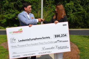 (LEFT to RIGHT) Houstoun Demere, Vice President of enmarket, presents check to Dana Stevens, Area Director of the Leukemia and Lymphoma Society handsake