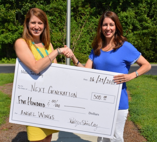 (LEFT TO RIGHT) Neilie Dunn, President of Next Generation, accepts donation from Robyn Shirley, Independent Trunk Keeper & Team Leader with Matilda Jane Clothing