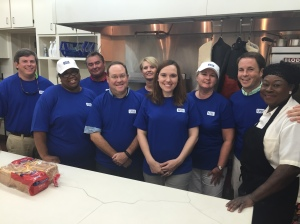 (LEFT TO RIGHT) USI employees: Walter Hagan, Wendy Robins, Frank Garrison, Chris Miller, Vicky Carter, Susan Breen, Lori Hampton, Nick Puhala, and Emmaus House chef, Freda Payne
