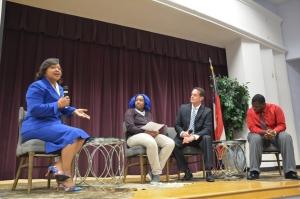 (LEFT TO RIGHT) Dawn Baker, speaker Maya Jackson, student at Savannah High David Klugh, emcee Kristopher Bonds, student at Savannah High