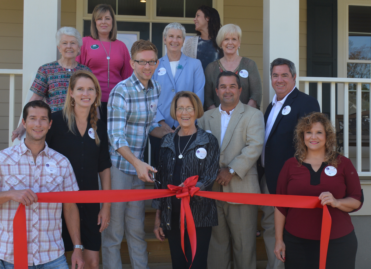 beside-their-mother-gretchen-greene-front-center-trina-and-travis-dodd-front-left-cut-the-ribbon-on-the-new-gretchen-greene-school-of-dance-studio-the-dewitt-tilton-group-completed-this-project